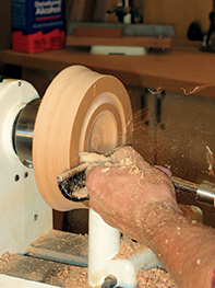 Turning a bowl attached to a faceplate on a lathe