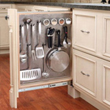 Narrow space-filling storage cabinet