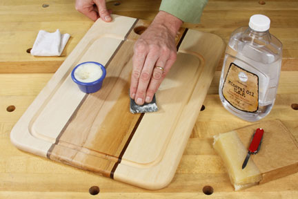 Finishing a cutting board with mineral oil mixed with beeswax