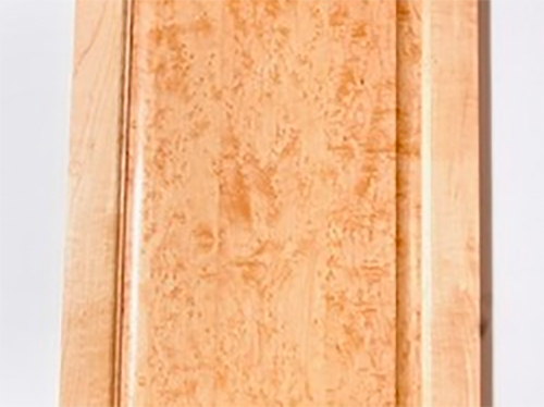 A non-uniform stain applied across a maple cabinet panel