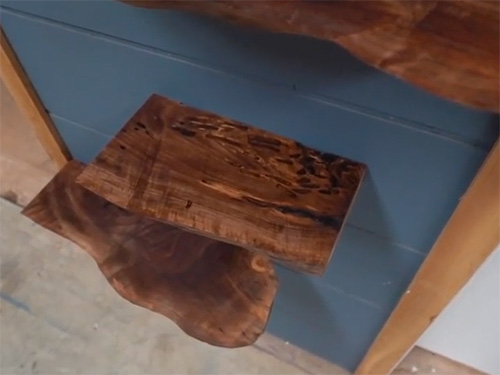Floating live edge walnut shelving with unique features