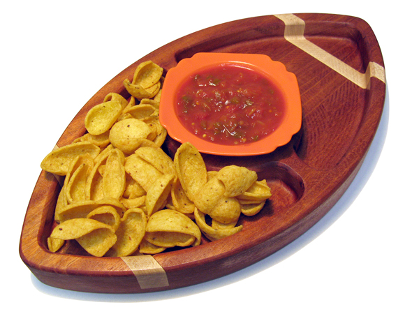 Football shaped snack tray with chips and salsa