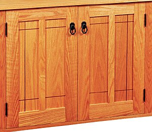 Cabinet door with frame and panel construction and slight reveal for wood expansion
