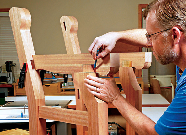 woodworker measuring a mortise and tenon joint