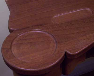 Routed recess in a game table for storing cards and poker chips