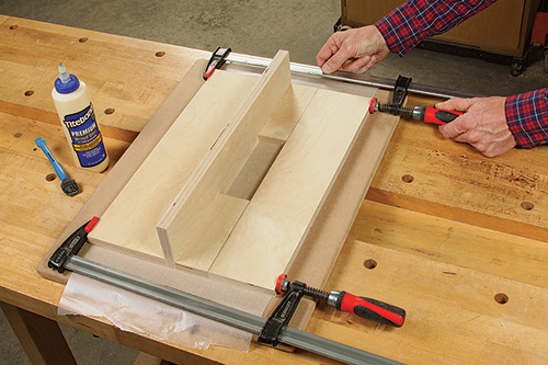 Gluing base and fence for plunge router jig and clamping pieces together