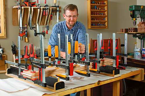 Gluing and clamping set-up for storage box panel assembly