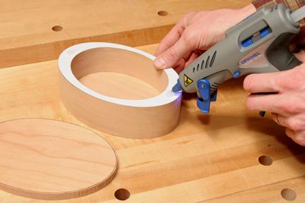 Using hot melt glue to mount lid to top of keepsake box