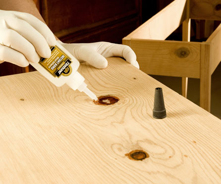 Using cyanoacrylate glue to repair a knot in a wood panel