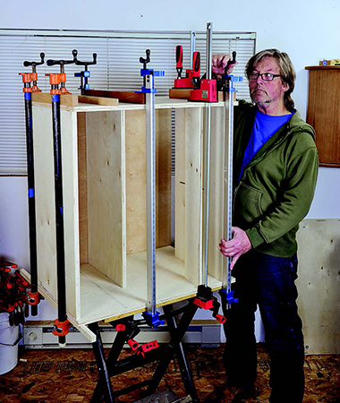 Gluing and clamping casework for top portion of tool storage cabinet
