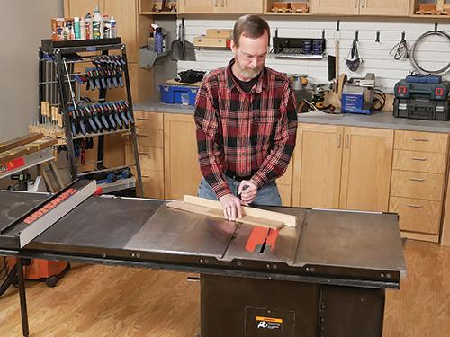 Guiding a lumber cut using a miter gauge