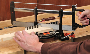 Using a handsaw and miter box to cut smooth miters