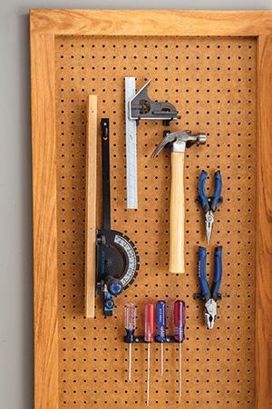 Hanging miter gauge on a workshop pegboard