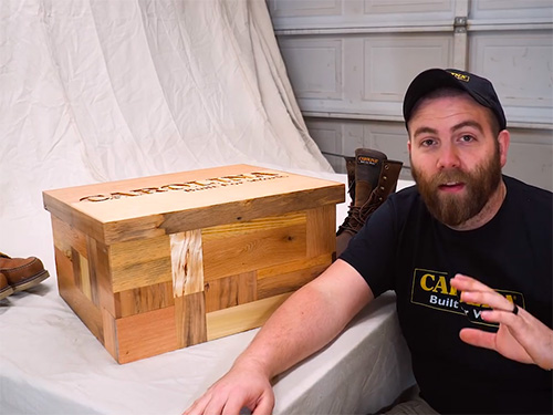 Paul Jackman displays a multi-panel pallet wood boot box with secret compartment