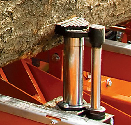 Hydraulic clamp with foot to hold log in place on band saw mill