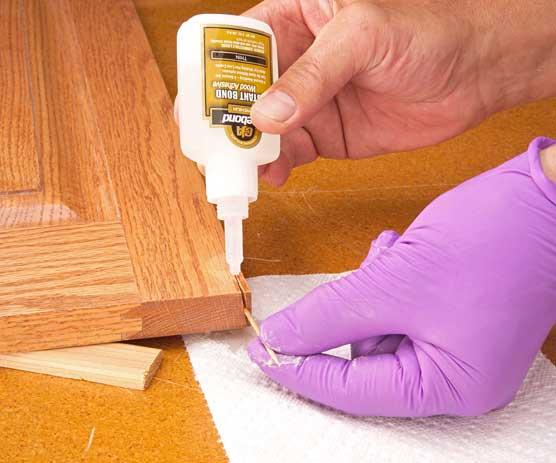 Adding cyanoacrylate glue to close crack in wood