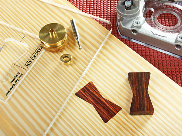 Butterfly key cutting tools and an installed key