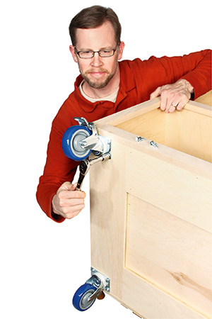 Securing heavy duty casters to base of miter saw cabinet