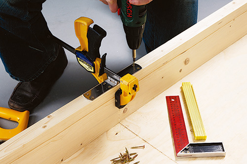 Clamping convertible coffee table bed halves together to install hinges