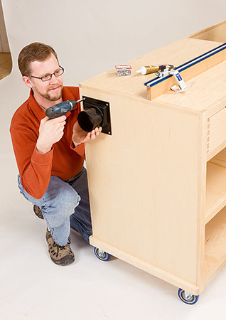 Attaching dust port to miter saw station dust chamber