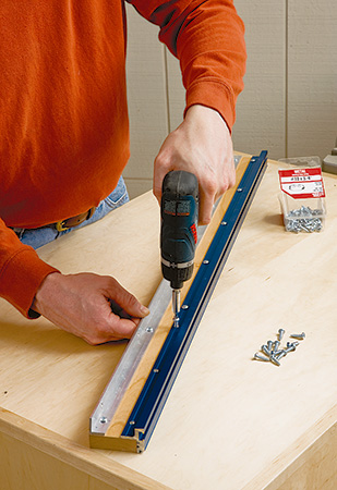 Assembling parts of t-track miter saw fence