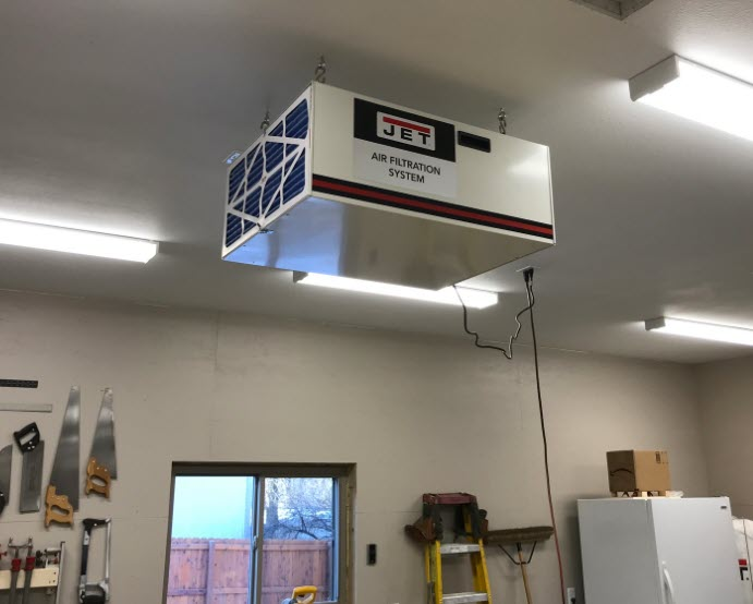 Jet air filtration system handing from workshop