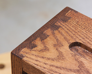 Dried glue filling the gaps around a dovetail joint