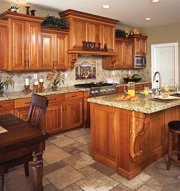 Upper and lower kitchen cabinets with an island