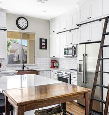 Three tiered kitchen cabinets with access ladder