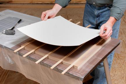 Applying laminate across scrap wood spacers