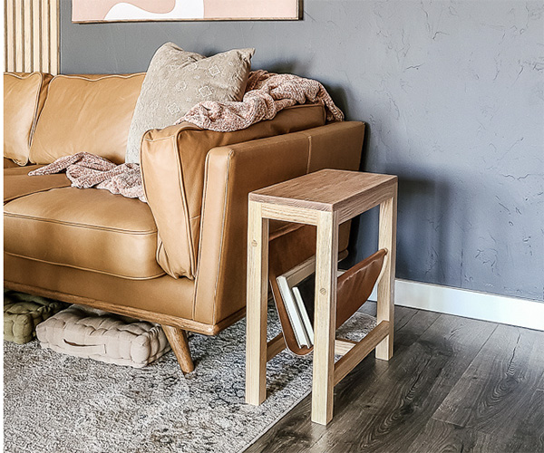 wood side table with leather magazine rack