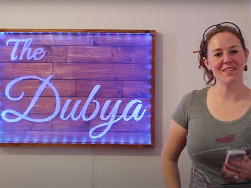 April Wilkerson and her bar sign with led backlights