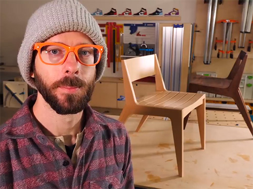 Chris Salomone with a pair of angular dining chairs