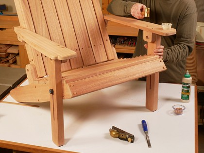Finishing up an adirondack chair with a block plane on the bench