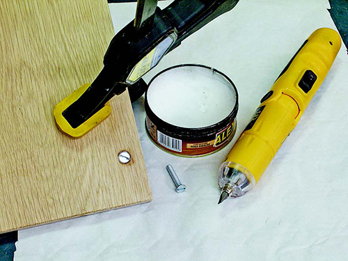 Using parafin wax to lubricate screws for miter cutting sled