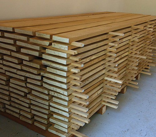 Lumber on a pallet in a kiln stacked for drying