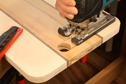 Cutting out cutting board handle with a jigsaw