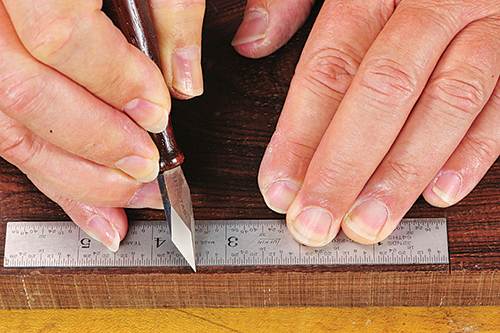Marking cut line with marking knife and rule