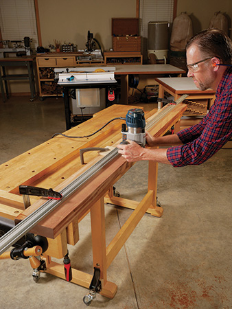 man flattening wood plank with router