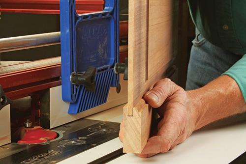 man putting together door