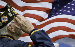 man saluting united states flag