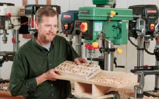 man using benchtop drill press