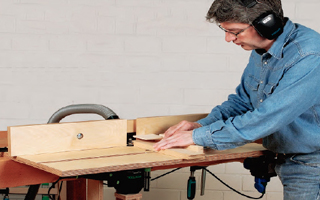 man using clamp-on workbench router table