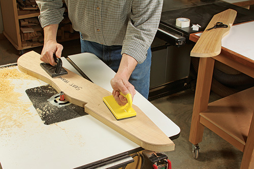man using router table with push blocks