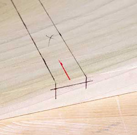 Marking out the size, depth and direction of dado cut