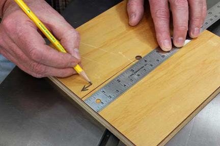 Marking the front edge of workpiece before sawing