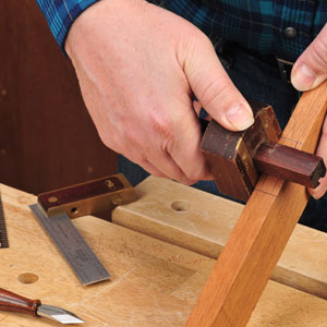 Using a marking gauge to set mortise cuts