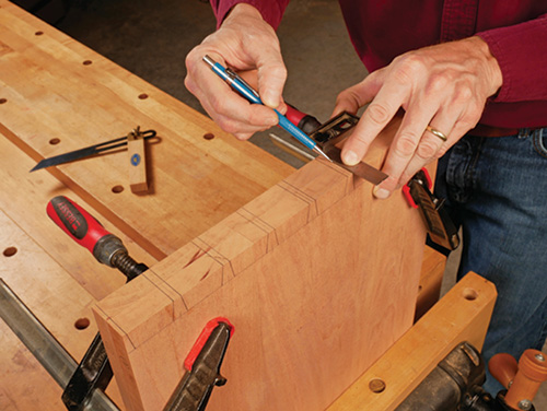 Clamping panels together to mark out full dovetail pattern