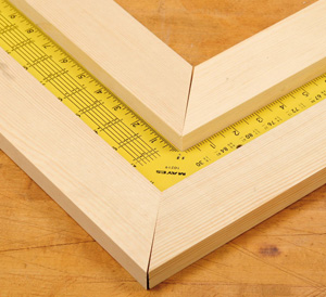 Using a square to measure the angle of a miter joint