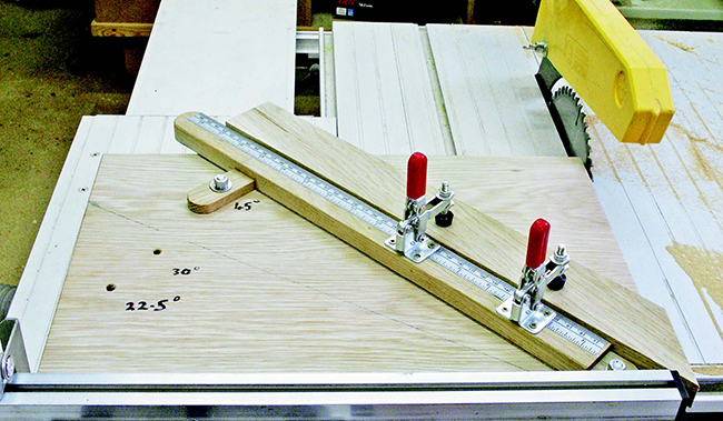 Sled for cutting miters at a table saw